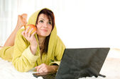 Woman with laptop and apple — Stock Photo
