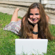 Beautiful girl with a laptop outdoor — Stock Photo #6851050