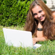 Beautiful girl with a laptop outdoor — Zdjęcie stockowe