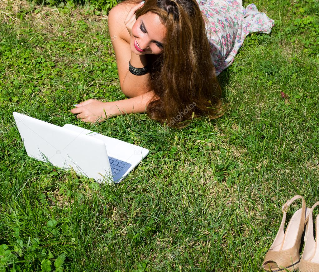 Beautiful girl with a laptop on nature — Stock Photo #6861655