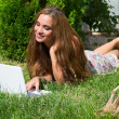Beautiful girl with a laptop outdoor — Stock Photo #6891264