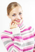 Beautiful girl in colored sweater on a light background — Stock Photo