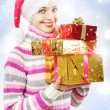 Santa girl with Christmas gifts — Stock Photo