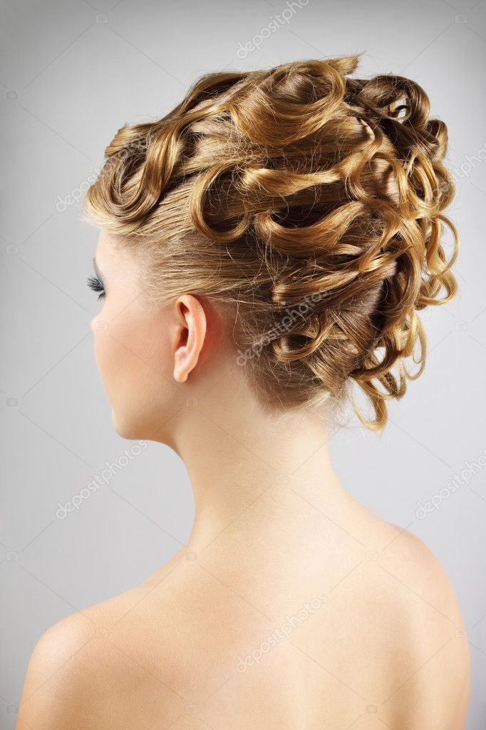 Young woman with beautiful hairstyle. gray background — Stock Photo #6958777