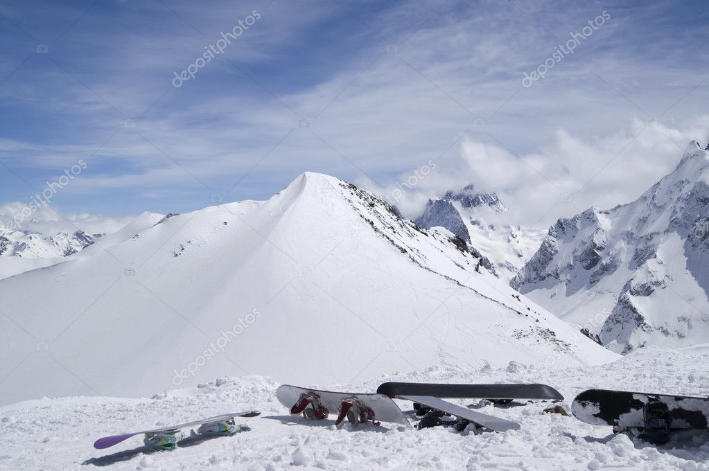 Snowboards against the top of mountain. Caucasus, Dombay. — Stock Photo #7129251