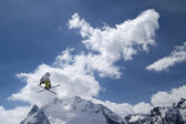 Freestyle ski jumper with crossed skis — Stock Photo