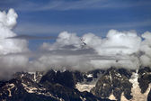 High Mountains covered with clouds — Stock Photo