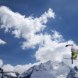 Stock Photo: Freestyle ski jumper with crossed skis