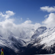 Panorama Caucasus Mountains. Slope with skier. - Stock Photo