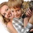 Happy mother and son with a cat — Stock Photo #7414578