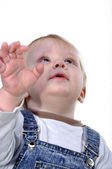 Toddler looking up and reaching — Stock Photo