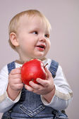 Baby boy with an apple — Stock Photo