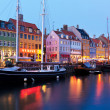 Evening scenery of Nyhavn in Copenhagen, Denmark - Stock Photo
