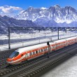 Railroad station in mountains with high speed train - Stock Photo