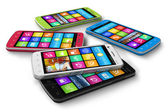 Set of color touchscreen smartphones — Stock Photo