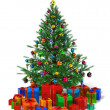 Decorated Christmas tree with heap of color gift boxes — Stock Photo