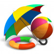 Beach items: color umbrella, ball and lifesaver — Stock Photo
