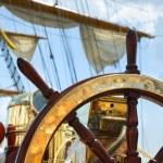 Old ship wheel — Stock Photo #7477399