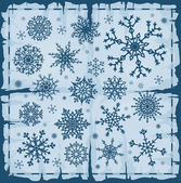 Set of different snowflakes over old damaged page. — Stock Vector