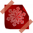 Red paper snowflake over red sticker — Stock Vector