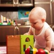 Stock Photo: Baby girl playing