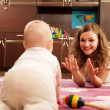Stock Photo: Mother playing with baby