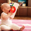 Baby eat tomato — Stock Photo