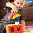 Little boy is building tower — Stock Photo #7658177