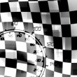 Stock Photo: Racing flag speedometer