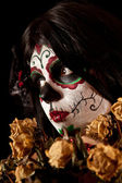 Portrait of Sugar skull girl with dead roses — Stock Photo