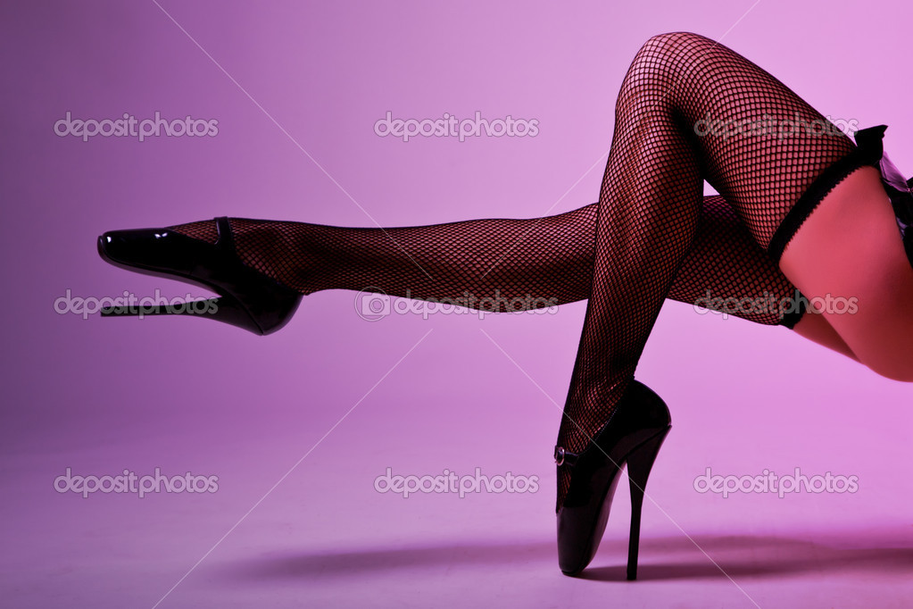 Sexy female legs in fishnet stockings and extreme fetish ballet shoes, studio shot  — Stock Photo #7136747