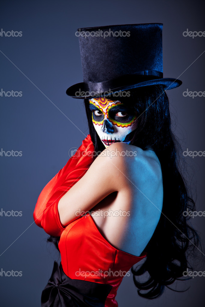 Sugar skull girl in tophat and red dress, studio shot — Stock Photo #7605779