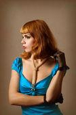 Beautiful retro woman in blue dress — Stock Photo