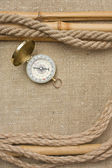 Compass with ropes and bamboo on canvas — Stockfoto