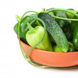 Green peppers, cucumbers and garlic in a bowl — Stock Photo
