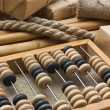 Pile parcel wrapped with brown kraft paper and abacus — Stock Photo #6909290
