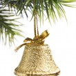 Gold bell on the Christmas tree — Stock Photo
