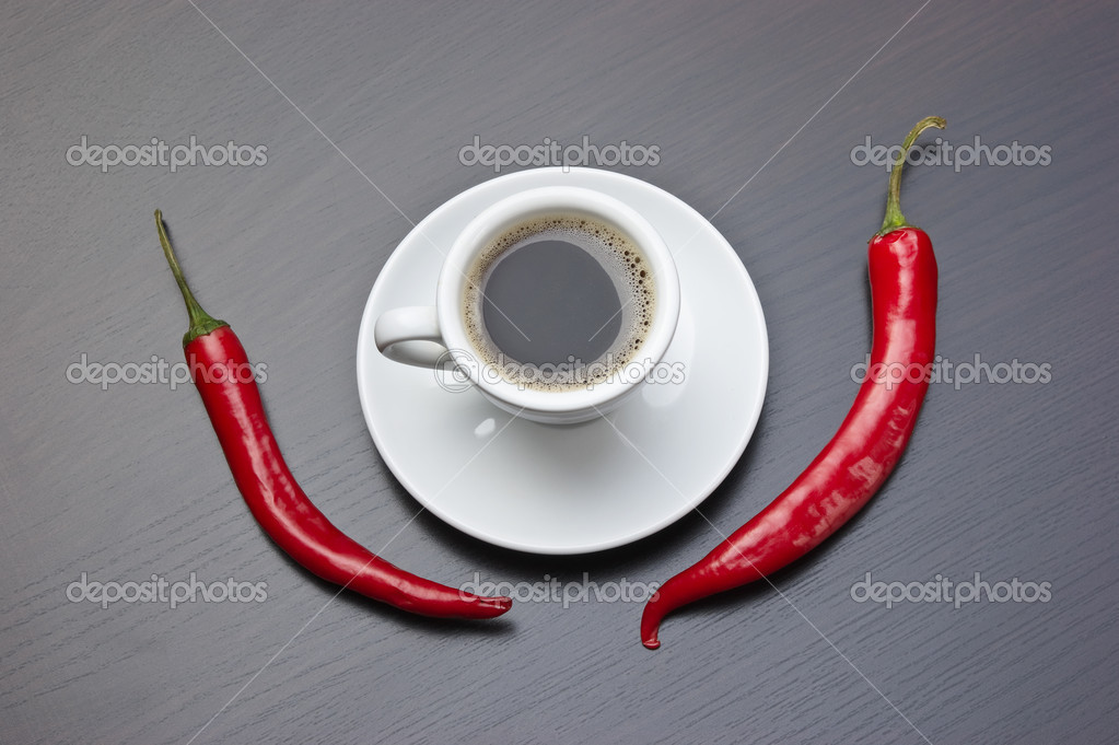 Coffee cup and red chili peppers — Stock Photo #6950939