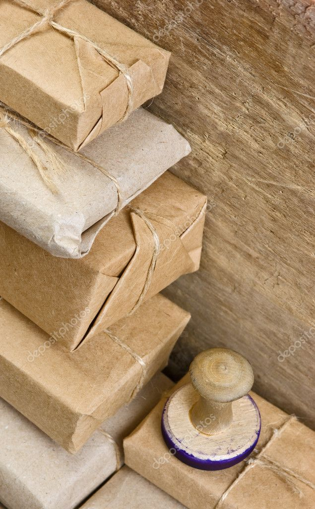 Pile parcel wrapped with brown kraft paper and tied with twine — Stock Photo #6951042