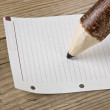 Note and wooden pencil - Stock Photo