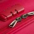 Combination lock on a pink suitcase — Stock Photo