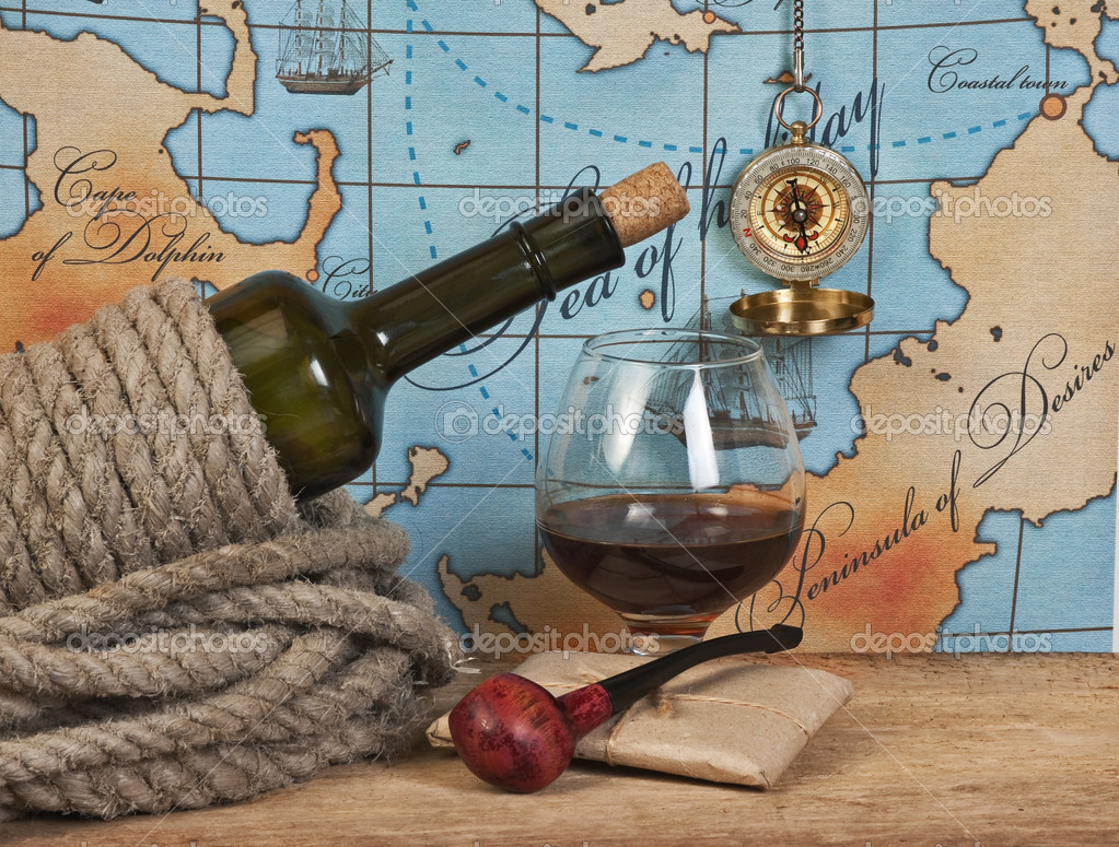 Bottle and  glass of wine on background of old maps — Stock Photo #7267559