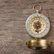 Compass on wooden background - Foto Stock