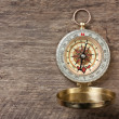 Compass on wooden background - Stockfoto