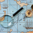 Magnifier and compass on  map - Stockfoto