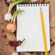 Notebook for recipes and spices — Stock Photo