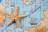 Starfish on map — Stock Photo