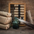 Stock Photo: Pile parcel and abacus