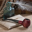 Postal parcel, tobacco pipe and inkwell — Stockfoto