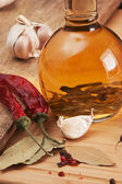 Bottle with marinade and spices — Stock Photo